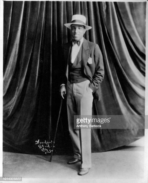 Portrait of actor Ossie Lyles as he poses with a walking stick Chicago Illinois 1927