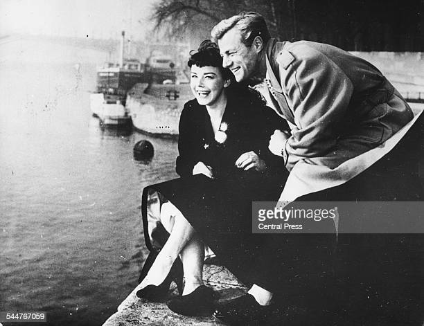 Portrait of actor Tony Wright with his new wife Janet Munro sitting by the Seine on their honeymoon in Paris January 15th 1957