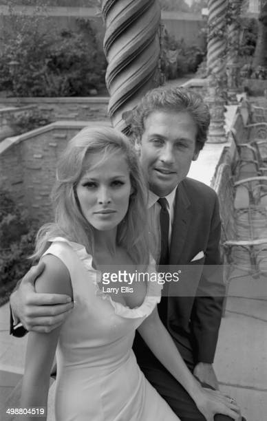 Portrait of actor Ursula Andress and John Richardson on a balcony August 12th 1964