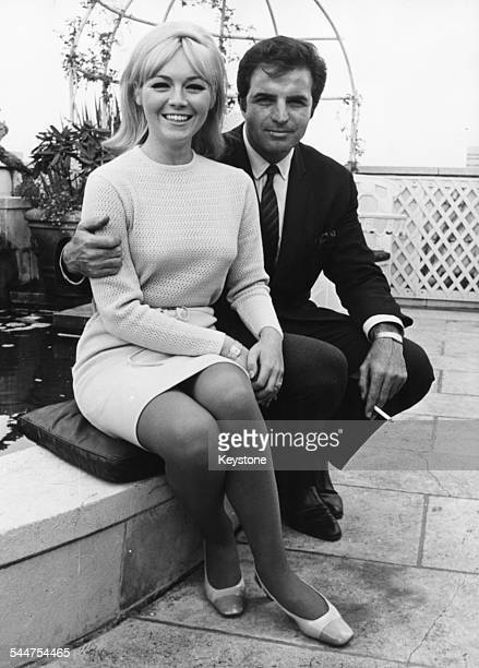 Portrait of actor Vincent Edwards and his wife sitting in a roof garden in London August 30th 1967