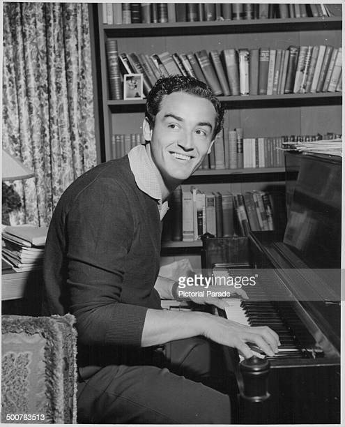 Portrait of actor Vittorio Gassman playing the piano in his home following his appearance in the movie 'Rhapsody' 1954