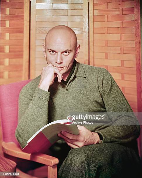 Portrait of actor Yul Brynner with a script circa 1960