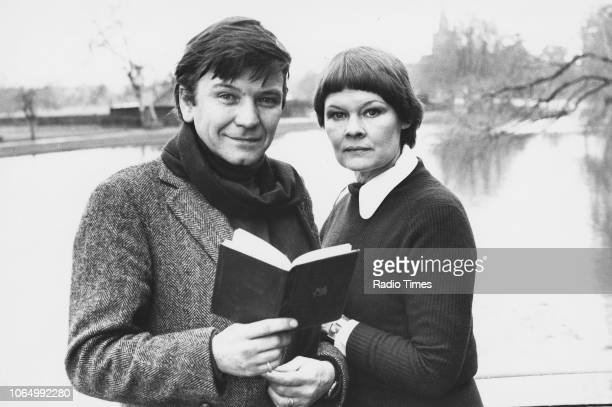 Portrait of actors and spouses Judi Dench and Michael Williams standing next to a river January 27th 1977