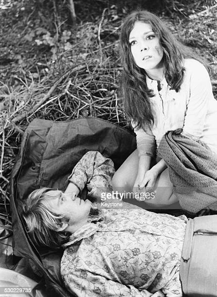 Portrait of actors David Warner and Diana Rigg posing in the grounds of Compton Verney on location filming 'A Midsummer Nights Dream' Warwickshire...