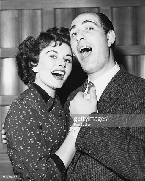 Portrait of actors Eunice Gayson and Alfred Marks rehearsing a duet together for the ITV show 'Alfred Marks Time' Toynbee Hall London May 9th 1956