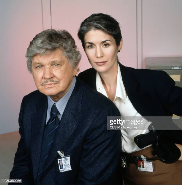 Portrait of actors, from left, Charles Bronson , Kim Weeks in BREACH OF FAITH:A FAMILY OF COPS II. Original broadcast February 2, 1997.