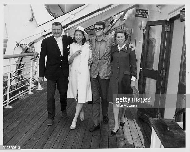 Portrait of actors Jack Hawkins and Peter O'Toole with their wives aboard a ship prior to their joint family trip to Acapulco June 8th 1967