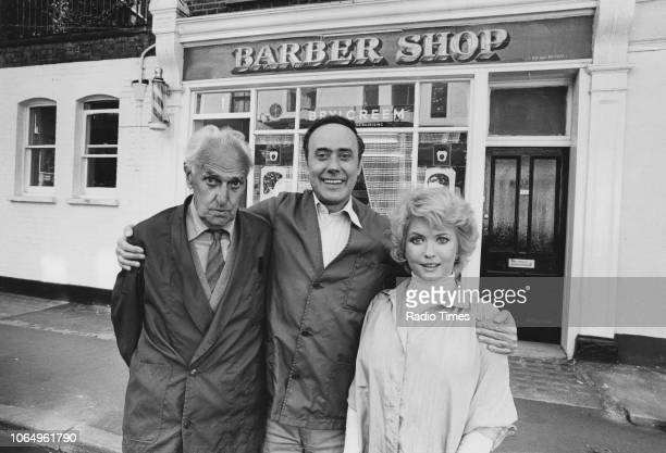 Portrait of actors John Laurie Victor Spinetti and Deborah Watling outside a barber's shop photographed for Radio Times in connection with the BBC...