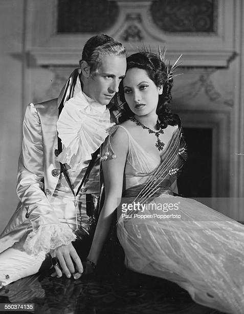Portrait of actors Leslie Howard playing the character of Sir Percy Blakeney and Merle Oberon in costume as Lady Blakeney as they appear in the film...