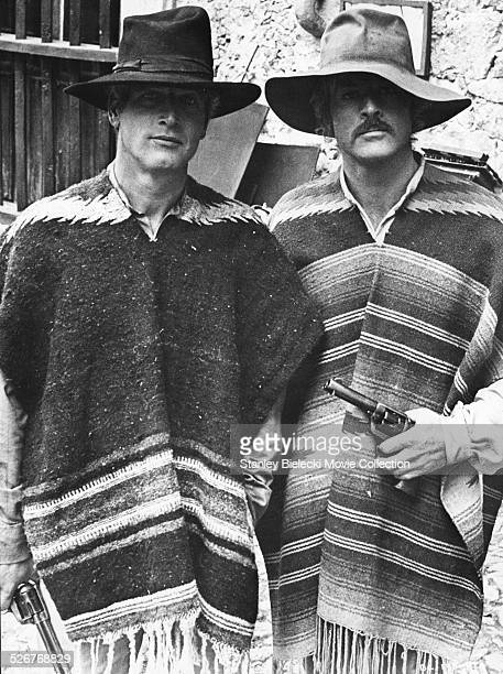 Portrait of actors Paul Newman and Robert Redford wearing ponchos and hats on the set of the movie 'Butch Cassidy and the Sundance Kid' 1969