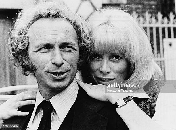 Portrait of actors Pierre Richard and Mireille Darc promoting their new film 'The Return of the Tall Blond Man' circa 1974