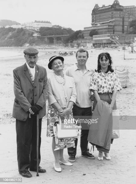 Portrait of actors Robin Bailey, Liz Smith, Peter Skellern and Liz Goulding at the beach, photographed for Radio Times in connection with the...