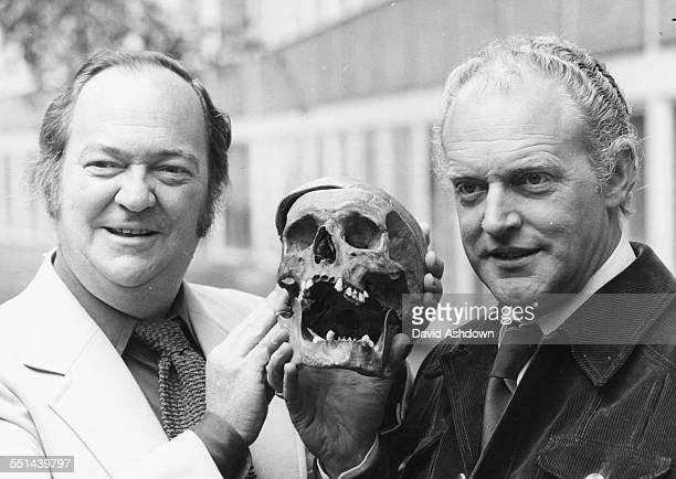 Portrait of actors Stratford Johns and Frank Windsor holding a skull promoting their new show 'Second Verdict' at BBC Television Centre London May...