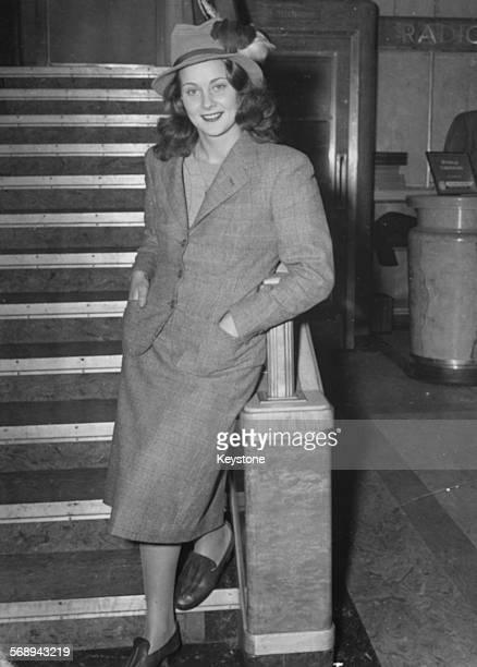 Portrait of actress Alida Valli standing on a staircase aboard the Queen Elizabeth ship en route to Hollywood January 1st 1947