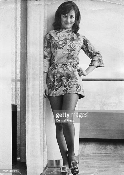 Portrait of actress Amanda Reiss star of the new play 'The Four Sided Triangle' wearing a patterned minidress and heels London February 24th 1970