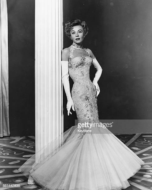 Portrait of actress and dancer Vera-Ellen wearing a ball gown, custom made for her for the Royal Film Performance, circa 1950.