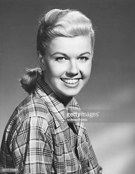 Portrait of actress and singer Doris Day wearing a plaid shirt for Warner Bros Pictures circa 1945