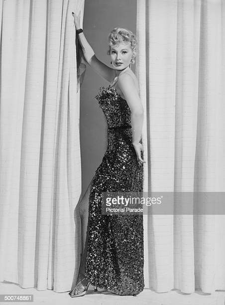 Portrait of actress and socialite Zsa Zsa Gabor wearing a sequined dress and fishnet stockings circa 19501955