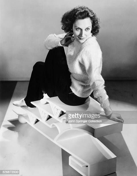 Portrait of actress Ann Dvorak sitting on a sculptural stool Dvorak starred in films from the 1920s to the 1950s