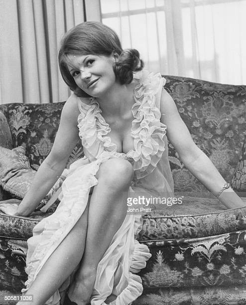 Portrait of actress Anna Palk wearing a glamorous sheer night gown in her Belgravia home London circa 1965