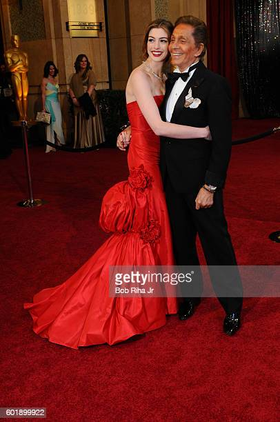 Portrait of actress Anne Hathaway and fashion designer Valentino as they pose on the red carpet at the Kodak Theater during the 83rd Academy Awards...