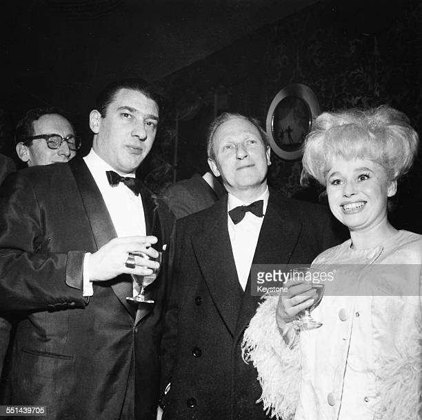 Portrait of actress Barbara Windsor with notorious East End gangster Ronnie Kray London circa 1960