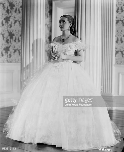 Portrait of actress Bette Davis wearing a Civil Warera dress as she appears in the film 'Jezebel' for Warner Bros Studios 1938