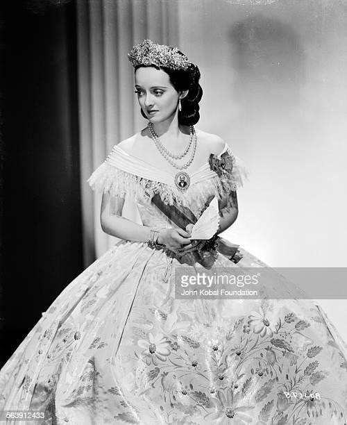 Portrait of actress Bette Davis wearing a Civil Warera dress as she appears in the film 'Juarez' for Warner Bros Studios 1939