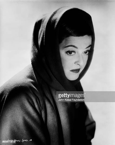 Portrait of actress Bette Davis wearing a head scarf, for Warner Bros Studios, 1940.