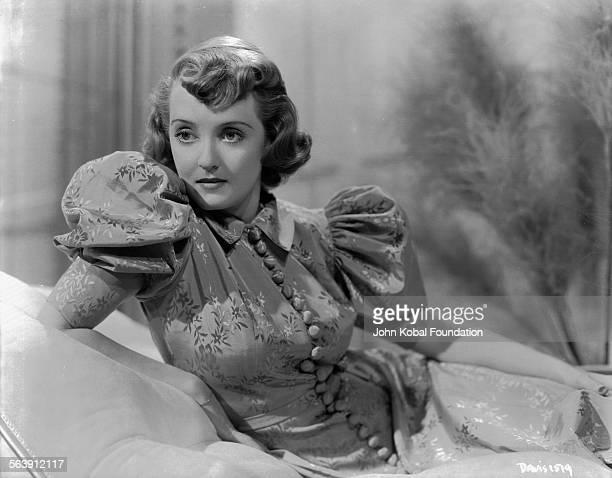 Portrait of actress Bette Davis wearing a puff sleeved dress for Warner Bros Studios 1931