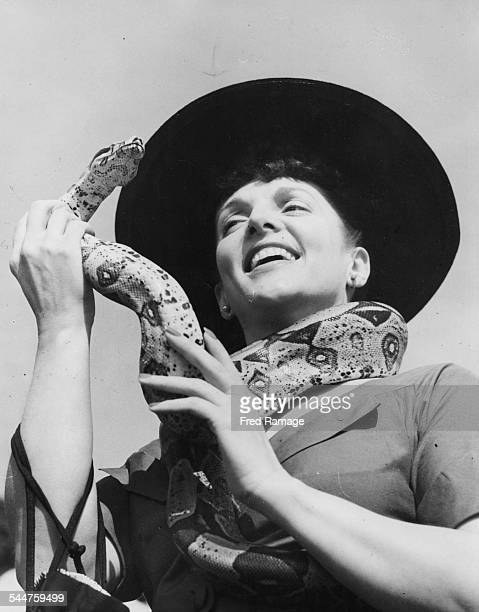 Portrait of actress Billie Worth with a snake draped around her neck as she celebrates her 21st birthday at Whipsnade Zoo England May 22nd 1952