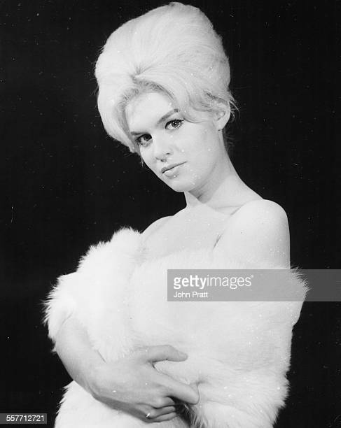 Portrait of actress Carol White with a beehive hair style wearing a fur stole February 1962