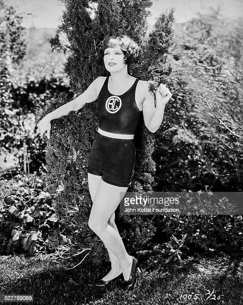 Portrait of actress Clara Bow wearing a bathing suit and high heels for Paramount Pictures 1926