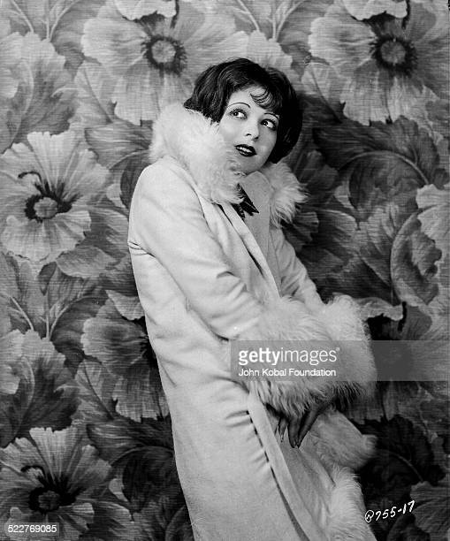 Portrait of actress Clara Bow wearing a furtrimmed robe for Paramount Pictures 1926