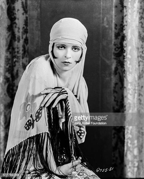 Portrait of actress Clara Bow wearing a headscarf for Paramount Pictures 1927