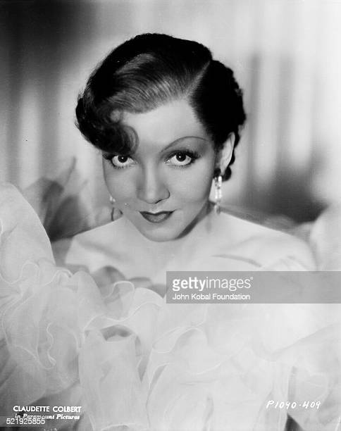 Portrait of actress Claudette Colbert surrounded by ruffles material for Paramount Pictures 1929