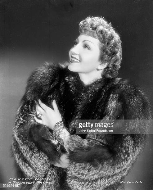 Portrait of actress Claudette Colbert wearing a fur coat for Paramount Pictures 1934