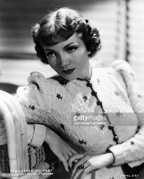 Portrait of actress Claudette Colbert wearing a knitted cardigan for Paramount Pictures 1934
