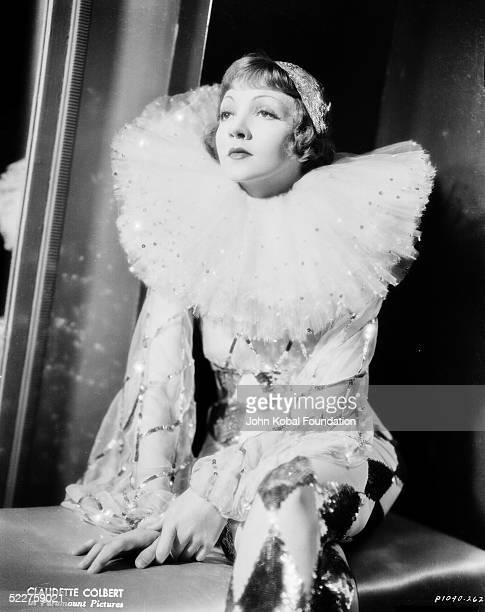 Portrait of actress Claudette Colbert wearing a ruff around her neck and a sequined costume as she appears in the movie 'Tonight Is Ours' for...