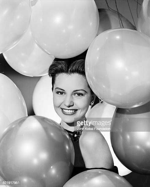 Portrait of actress Cyd Charisse surrounded by balloons for MGM Studios July 2nd 1947