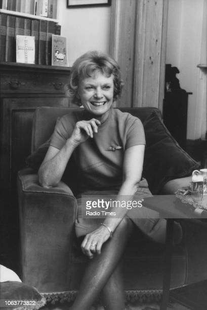 Portrait of actress Dame Anna Neagle sitting in an armchair March 2nd 1973