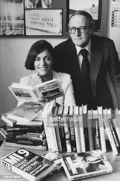 Portrait of actress Diana Quick and broadcaster Robert Robinson with a pile of books photographed at BBC Television Centre for Radio Times in...