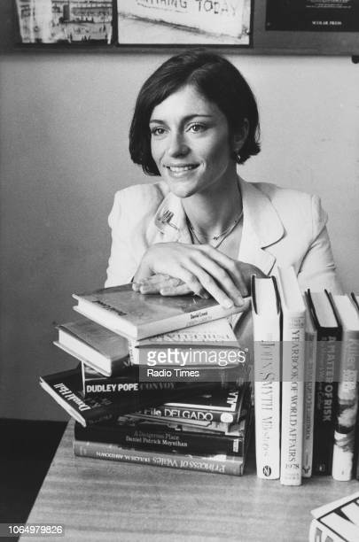 Portrait of actress Diana Quick with a pile of books photographed at BBC Television Centre for Radio Times in connection with the television show...