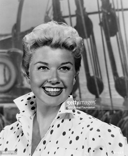 Portrait of actress Doris Day smiling and wearing a polka dot blouse for Warner Bros Studios 1951