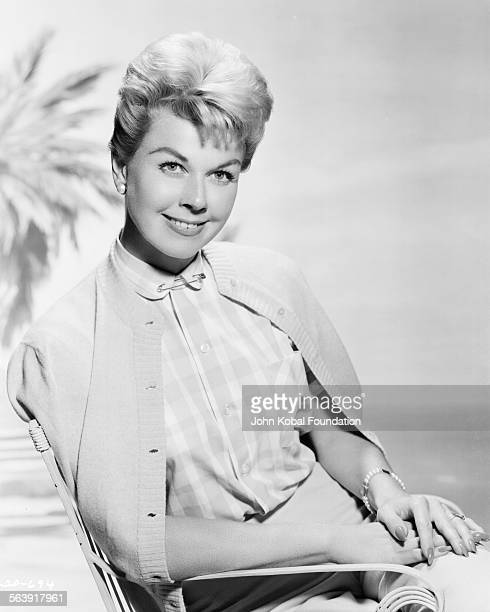 Portrait of actress Doris Day wearing a blouse and buttoned-down sweater, for Warner Bros Studios, 1951.