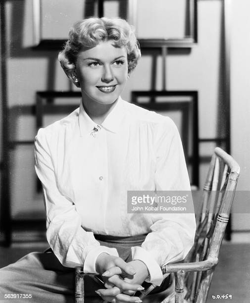 Portrait of actress Doris Day wearing a buttonedup blouse for Warner Bros Studios 1951