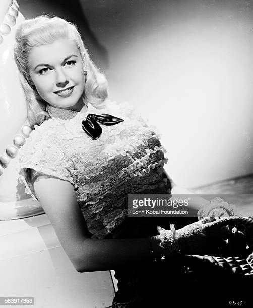 Portrait of actress Doris Day wearing a laceruffled blouse for Warner Bros Studios 1951