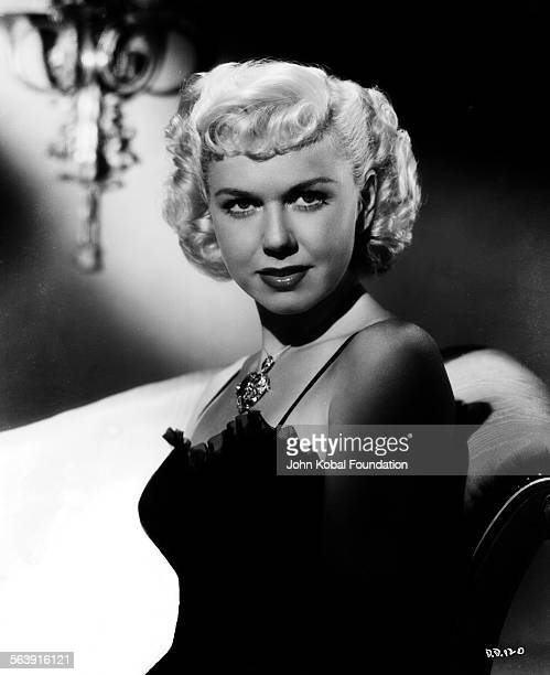 Portrait of actress Doris Day wearing a lacetrimmed evening dress for Warner Bros Studios 1951