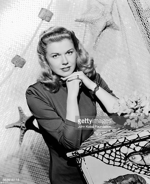 Portrait of actress Doris Day with a fishing net behind her for Warner Bros Studios 1951