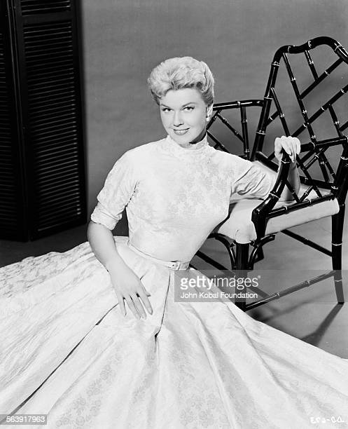 Portrait of actress Doris Day with her skirt fanned out around her for Warner Bros Studios 1951